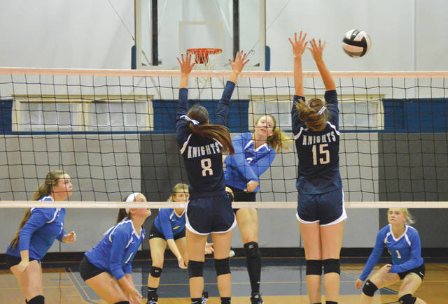 Xenia's Heidi Alex (7) hits around the block of Legacy Christian Academy's Meriya Angel (8) and Renee Fear (15), during Monday's Sept. 24 girls high school volleyball match at Legacy Christian.