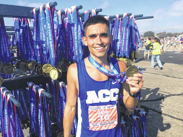 Submitted photo Jake McCubbin, who ran cross country for WSU from 2008-12, won the 22nd Annual Air Force Marathon, Sept. 15 at Wright-Patt Air Force Base.