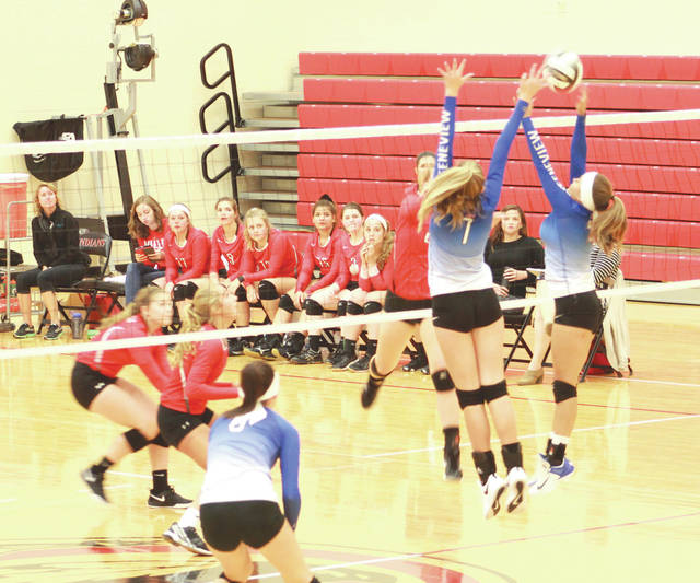 Greeneview freshman Sarah Trisel (7) and senior Bryce Ratliff (5) team up to make a block, Sept. 27, in an Ohio Heritage Conference girls high school volleyball match against host Cedarville.