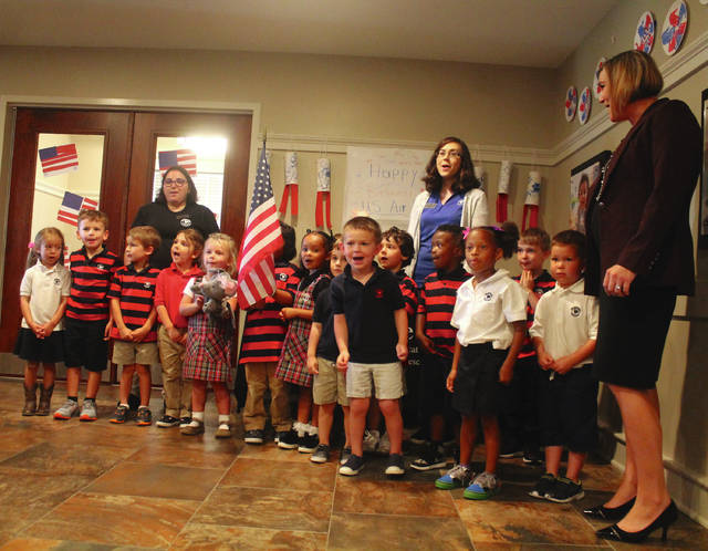 "Anna Bolton | Greene County News Pre-Kindergartners, with teachers Ariana Milanese, Katherine Fanizzi and franchise owner Colleen Clemens, sing ""Happy Birthday"" to the Air Force Sept. 18 at Primrose School of Beavercreek."