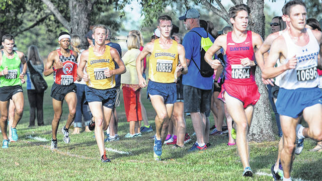 Submitted photo Ethan Sullivan (right) and Trenton Classen run with the Friendship Invitational leaders.