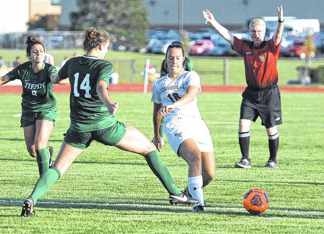 Submitted photo Rachel Wiggins maneuvers around opponent as she passes the ball.