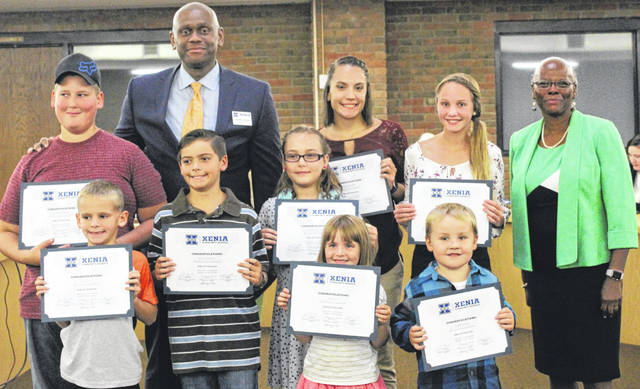 Submitted photo At this month's Xenia Community School District Board of Education meeting, eight Kids of Character were recognized for their positive attitudes and academic successes: Stanlee Forinash (Xenia Preschool); Rocco DeMartino (Arrowood Elementary); Kloe Moore (Cox Elemenentary); Nathaniel Kingsolver (McKinley Elementary); Tucker Lamb (Shawnee Elementary);, Kadence Henderson (Tecumseh Elementary); Grace Smith (Warner Middle); and Alexandra Fellie (Xenia High). They are pictured with Superintendent Dr. Gabe Lofton and board President Cheryl Marcus. Read more about these Buccaneers at www.xenia.k12.oh.us.