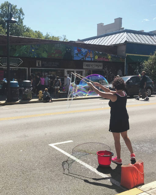 Anna Bolton | Greene County News The Village of Yellow Springs recently hosted its annual Bubblefest. The event has no agenda other than inviting individuals to blow bubbles on the village's sidewalks.