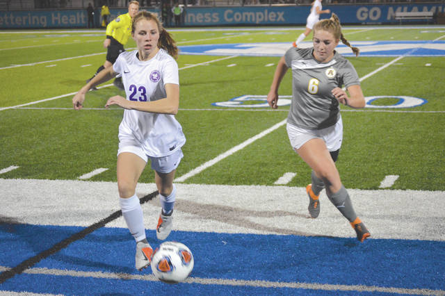 Bellbrook's Bailey Sedlak (23) drives around Alter's Julia Ruffolo in the second half of Tuesday's Oct. 30 girls high school soccer Division II regional semifinal match at Miamisburg's Holland Field.