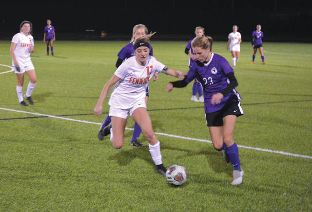 Junior forward Bailey Sedlak (23) battles for control of the ball with Fenwick's Alex Page, during the first half of the Oct. 23 Division II sectional final at Fairmont High School in Kettering. Sedlak scored both Bellbrook goals in a 2-1 overtime win.