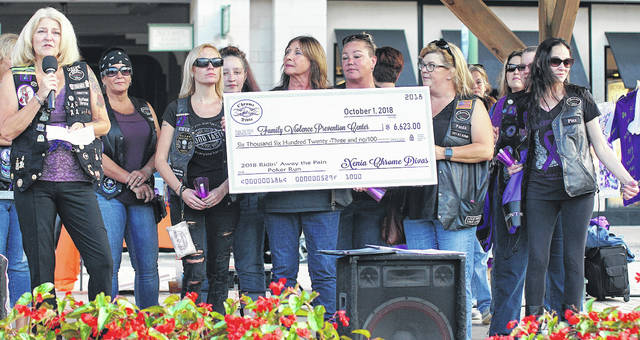 The Xenia Chrome Divas present a check to the FVPC.