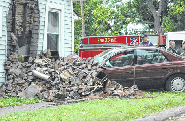Scott Halasz | Greene County News A car slammed into a home at the corner of Cincinnati Avenue and Charles Street causing major damage to the chimney. The residents will be able to stay in the home, according to fire officials.