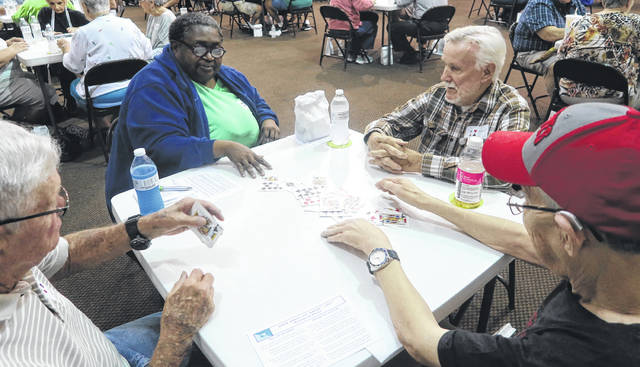 Submitted photos More than 100 seniors participated in the Greene County Council on Aging Euchre tournament at the Greene County Fairgrounds.