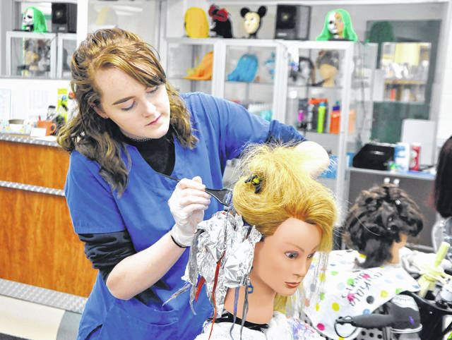 Photo courtesy of GCCC Senior Krista Hall from Fairborn practices hair coloring in the Cosmetology lab at Greene County Career Center.