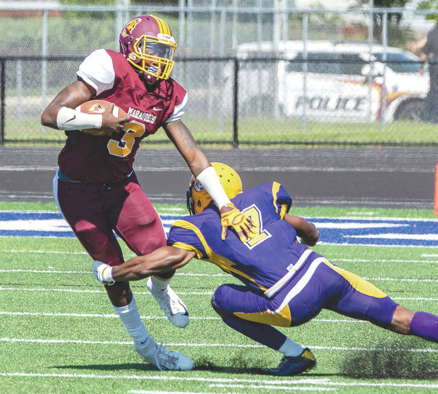 Central State wide receiver Kevin Greenhow tries to elude the tackle of Benedict College defensive back Robert Cummings, during Saturday's Sept. 29 college football game at Doug Adams Stadium in Xenia.