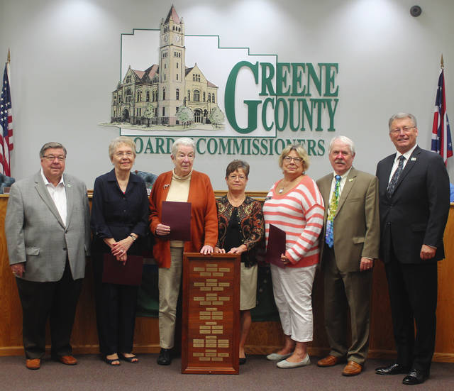 Anna Bolton | Greene County News At their Sept. 27 meeting, Greene County Commissioners recognize five local women who were recently inducted into the Greene County Women's Hall of Fame. Pictured: Commissioner Bob Glaser, Mary Smith of Beavercreek, Jane Baker of Yellow Springs, Paula Vaught of Xenia, Debborah Wallace of Beavercreek, Commissioner Alan Anderson and Commissioner Tom Koogler. Not pictured: Gloria Wade Dillon of Xenia.