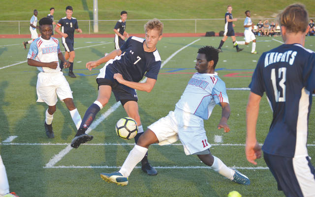 Legacy Christian sophomore Jonathan Riddle (7) steals the ball away from Belmont's Kasongo Lambert, in the first half of a boys high school soccer match on the Athletes in Action football field, in Xenia. Riddle scored both Legacy Christian goals in a 3-2 loss.