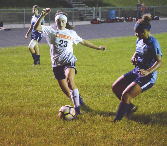 Beavercreek scoring leader Marcella Cash (23) drives downfield as Fairborn sophomore defender Jodee Austin closes in, Oct. 4, in a girls high school soccer match at the Fairborn Soccer Stadium.