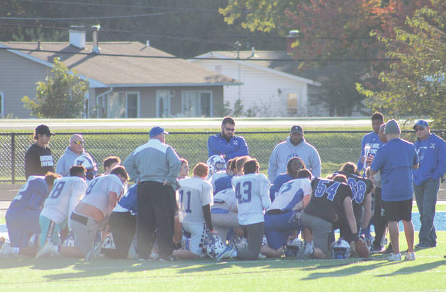 Xenia coach Smitherman and his assistants talk with the team following a practice Oct. 23, preparing for Thursday's Oct. 25 home game at Doug Adams Stadium against Greater Western Ohio Conference South Division rival Fairborn.