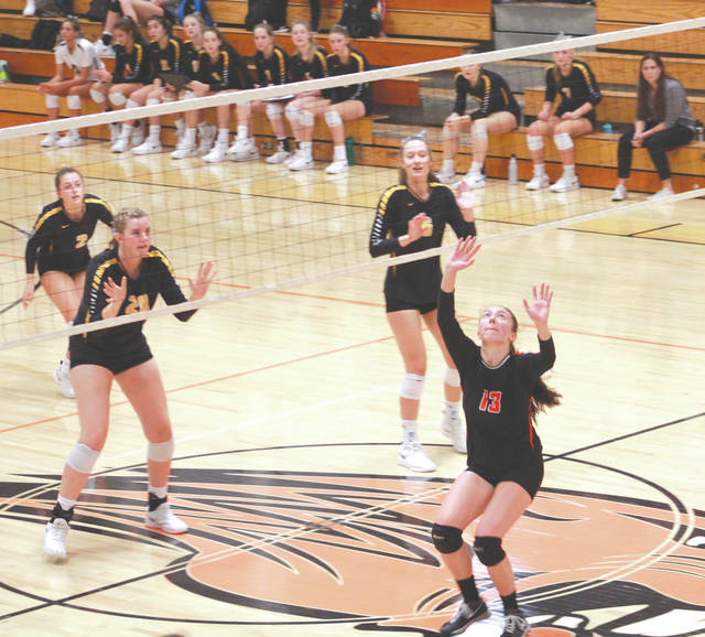 Beavercreek senior Kayla Vonder Embse (13) sets a pass in the second set that led to a point against Centerville, Oct. 10 at Beavercreek High School.
