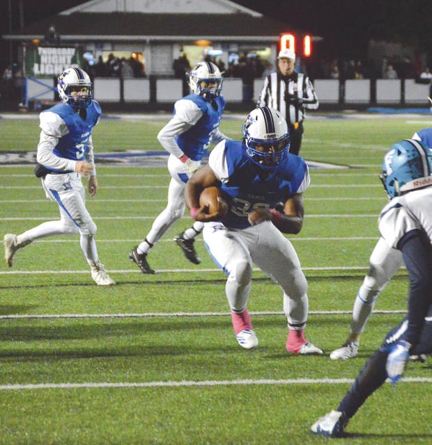 Sincere Wells carries the ball for his first touchdown run of the night, Oct. 25, in a 50-8 win over Fairborn at Doug Adam Stadium in Xenia.