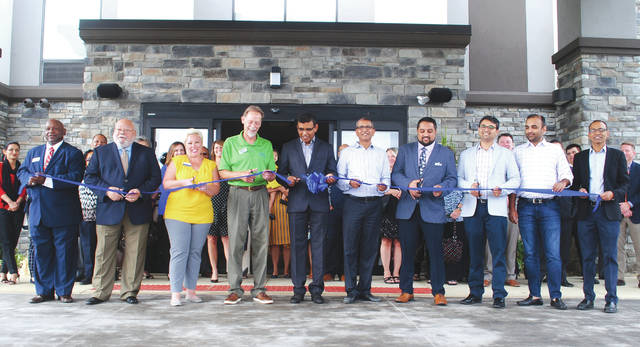 Whitney Vickers | Greene County News Hampton Inn Xenia-Dayton opened to the public Oct. 2. Hotel and city officials (pictured) said its the first mid-to-upscale hotel in the community and are thrilled about its opening.
