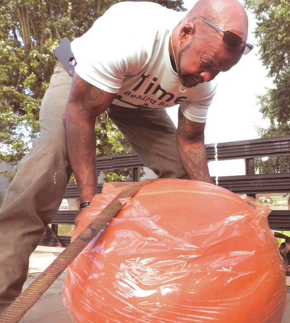 Submitted photos GCP&T Maintenance Supervisor Dave Dudgeon loads a pumpkin as preparations begin for the 2019 Pumpkin Glow.