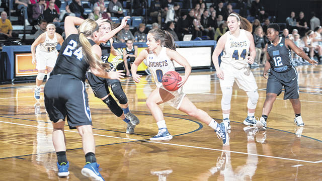 Photo courtesy of CU Cedarville University's Emily Chapman (0) drives to the basket, Nov. 20 in a home win over Ohio Christian University.