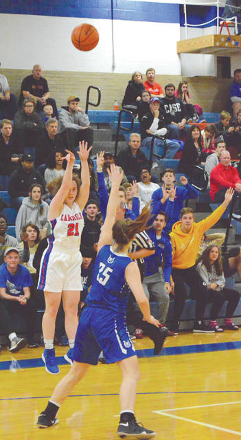 Carroll's student section knew Elizabeth Bush's 3-point shot was good as soon as it left her fingertips. They were right, during the first half of the Patriots' girls high school basketball home opener with Cincinnati Wyoming. Carroll hit 11 threes and won, 68-39, Nov. 23 in Riverside.
