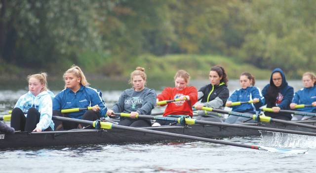 Members of the Dayton Boat Club's novice girls 8+ rowing crew practice in October. DBC girls novice team medaled in each event they entered at an October regatta in Columbus.