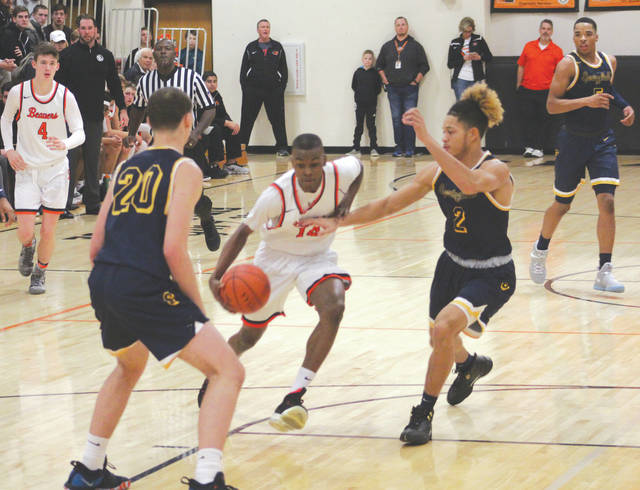 Beavercreek sophomore Isaiah Moore drives in for a layup against the Springfield defense.