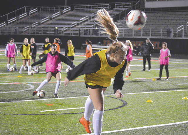 Beavercreek's Kate Helton knocks the ball into the goal during a header drill, Nov. 5, at Beavercreek High School's Frank Zink Field. The Beavers will take on Columbus Watterson on Tuesday night in a Division I girls state soccer semifinal at Springfield.
