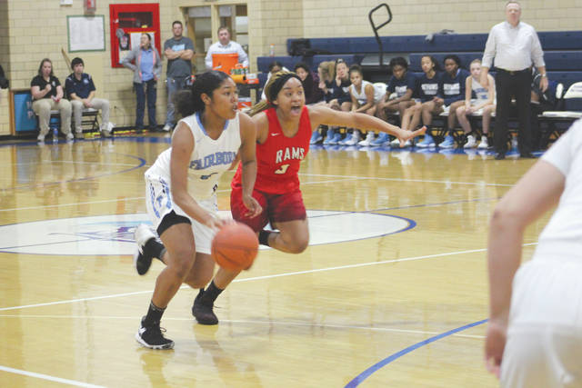 Fairborn's Khala Powell drives past a Trotwood-Madison defender, Nov. 28, in a 45-38 home loss to the Rams.