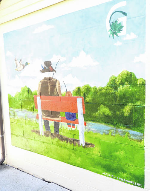 Submitted photos An original mural by Xenia artist Elizabeth Patterson now greets guests to Greene County Parks & Trails' Spring Lakes Park at 2191 Ferry Road in Bellbrook.