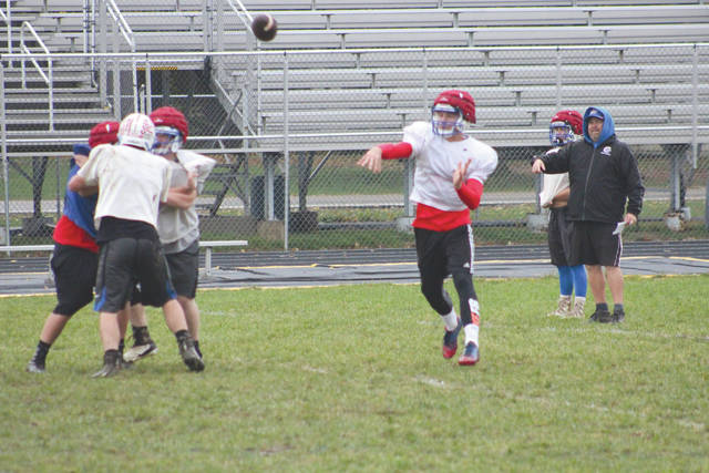 Rams quarterback Nick Clevenger throws a pass in practice during a Nov. 1 walk-through practice at Jamestown's Don Nock Field.