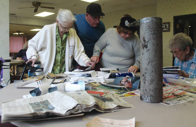 Anna Bolton | Greene County News Xenia's John Sale Manor residents open a 10-year-old time capsule Nov. 26. Soon they will create a new time capsule and bury it behind the apartment complex for another 10 years.