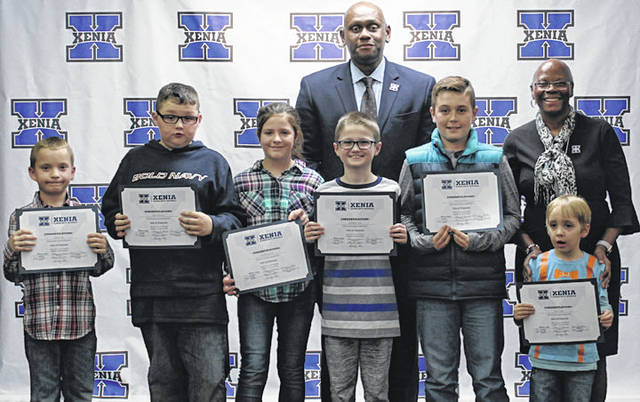 Submitted photo Xenia's kids of character pictured with Superintendent Dr. Gabe Lofton and board president Cheryl Marcus are Silas Currier, Wyatt Long, Elijah Roseman, Matthew Long, Rachel Graham, and Gavin McManus. Not pictured are Kylee Luckett and Rebecca West.