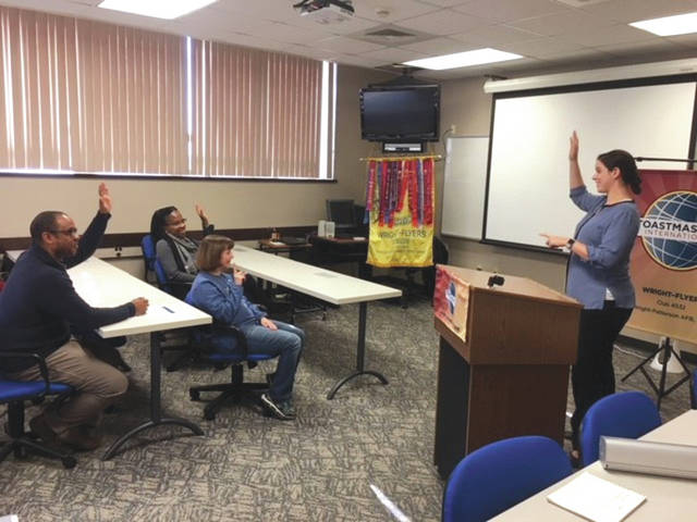 Submitted photo Officers of the Wright Flyer Toastmasters Club demonstrate a regular meeting, as a speech is being delivered at the lectern by Andrea Wolf, vice president of public relations for Wright Flyers Toastmasters. MSgt Kevin Alexander (left), Stephanie Richardson (center) and Angela Hayden (right) participate in Wolf's prepared speech.