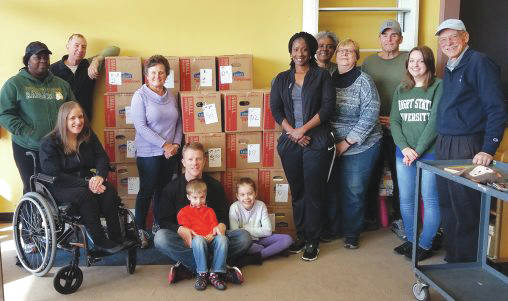 Submitted photo Alumni volunteered for community service at 11 local nonprofit organizations including Project READ, where they packed books for distribution throughout the community.