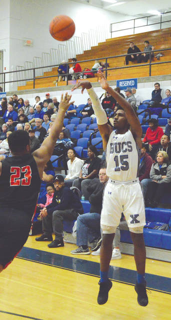 Xenia's Samari Curtis (15) puts up a 3-pointer over West Carrollton's Mykale Johnson, in the first half of a Greater Western Ohio Conference, American South boys high school basketball contest at Xenia High.