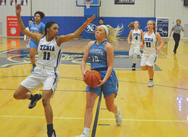 Fairborn's Evelyn Oktavec (10) drives in for a layup try as Xenia's Reaghan Wakefield goes for the block, during the first half of a girls high school basketball game, Dec. 19 at Xenia High School. Oktavec led all scorers with 18 points in the Skyhawks' win.