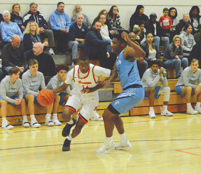 Beavercreek sophomore guard Isaiah Moore (14) drives the baseline against O.J. Person of Fairborn. Moore hit the winning 3-pointer with 2.2 seconds left to win the Dec. 11 game at Beavercreek High School.