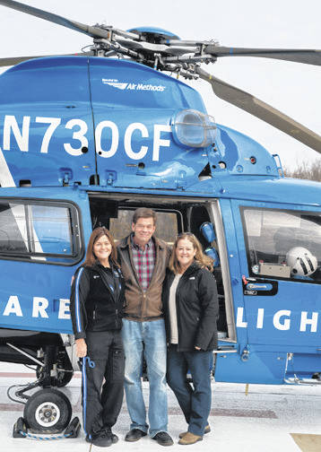 Submitted photos Marcia Roemer, the CareFlight flight nurse who provided care during the flight to Miami Valley Hospital, Mayor Eric Haas and his wife, Jan.