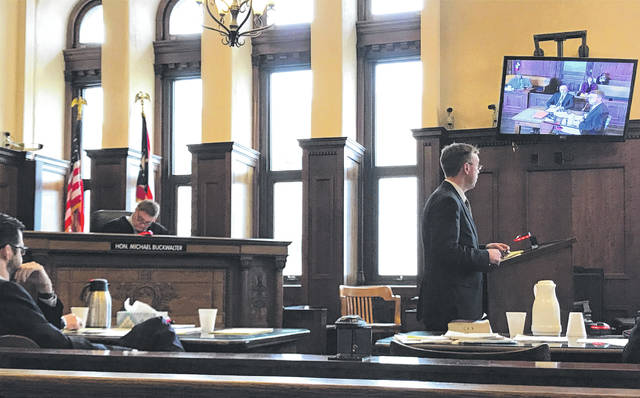 Anna Bolton | Greene County News Assistant Prosecutor David Morrison presents his opening argument to the jury as Defense Attorney John Leahy and Judge Michael Buckwalter listen Dec. 3 during the domestic violence trial.