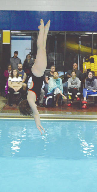 Beavercreek sophomore Sydney Filer enters the water after a preliminary dive, Dec. 13 at the Washington Township Recreation Center. Filer placed eighth in the girls competition between Beavercreek, Fairmont and host Centerville.