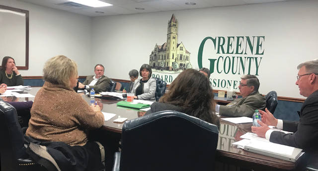 Anna Bolton   Greene County News Board of Elections Director Llyn McCoy, far left, and Greene County Commissioner Tom Koogler, far right, discuss new voting equipment during a Jan. 24 work session.