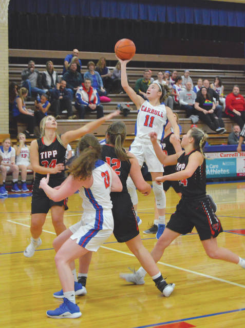 Carroll's Ava Lickliter (11) goes up for a shot, during the first half of Monday's Jan. 14 girls high school basketball game with Tippecanoe. Carroll won the nonleague contest, 56-39.
