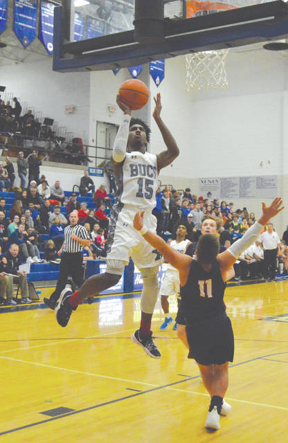 Samari Curtis (15) of Xenia scored a game-best 41 points in an 85-71 Buccaneers home win Jan. 11 over Piqua.