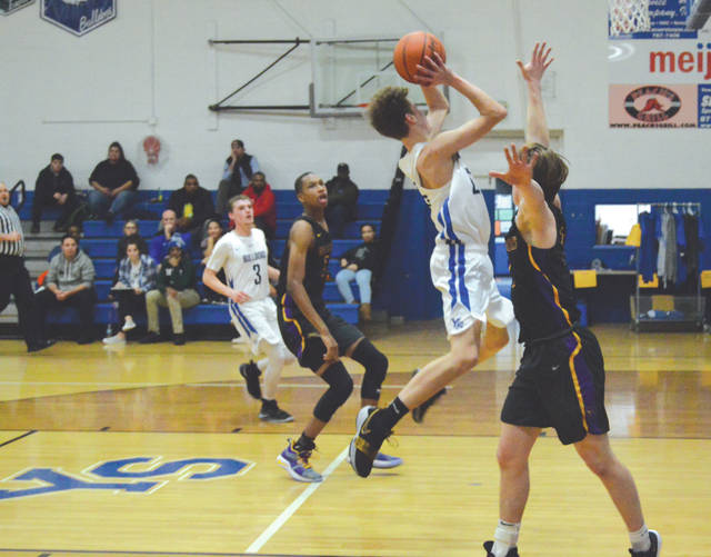 Yellow Springs' De Andre Cowen scores in the first half of Tuesday's Jan. 8 game against visiting Dayton Christian.