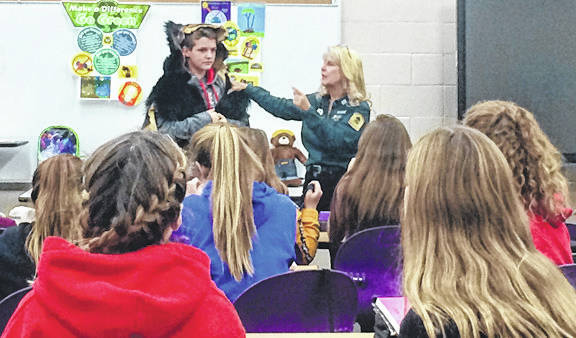 Submitted photos Kendra Schide — chief naturalist at Bellbrook-Sugarcreek Park District — speaks about endangered, threatened, and extinct species to Bellbrook Middle School students.