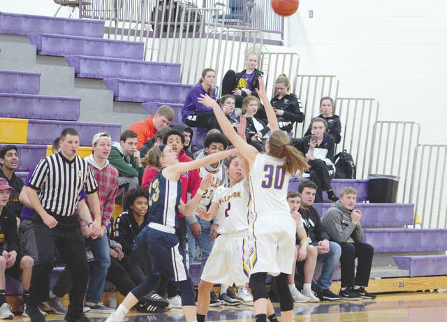 The Bellbrook student section gets rowdy as Golden Eagles senior Maria Mescher and junior Kayla Paul execute a trap off of a full-court press defense forcing a turnover, Jan. 26 against Southwestern Buckeye League opponent Oakwood.