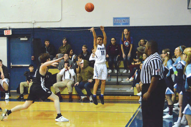 Roman Newsome (11) of Legacy Christian launches a 3-pointer during the second half of Tuesday's Jan. 22 boys high school basketball game against Yellow Springs. LCA connected on 14 3-pointers in the 91-49 win.