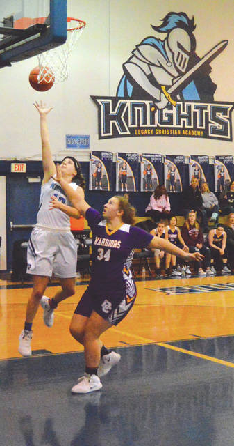 Emily Riddle of Legacy Christian Academy drives in for a layup in the first half of a win over Dayton Christian, Jan. 17 in Xenia. Riddle led all scorers with 21 points.