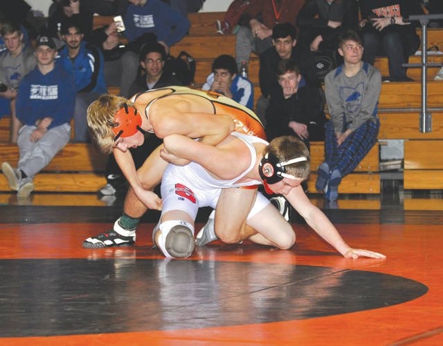 Lincoln Kuba of Beavercreek (top) defeated Stebbins' Charlie Blanton in the 120-pound championship match, Jan. 5 at Beavercreek High, and the host Beavers finished second to Springboro in the annual Beavercreek Invitational wrestling meet.